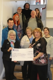 Bernadette receiving the cheque from club member Lesley